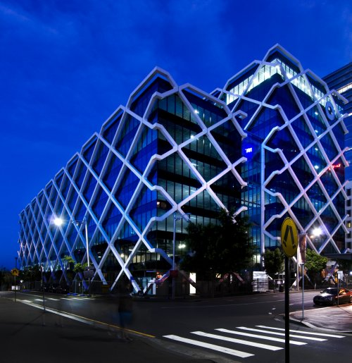 the innovative building design by architects fitzpatrickpartners includes a facade and central atrium that promotes natural light building facade lighting